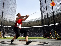 Germany's Betty Heidler hurls the hammer during the Women's Hammer competition at the ISTAF Athletics Meeting in Berlin, Germany, Sunday, Sept. 11, 2011. (AP Photo/Michael Sohn)